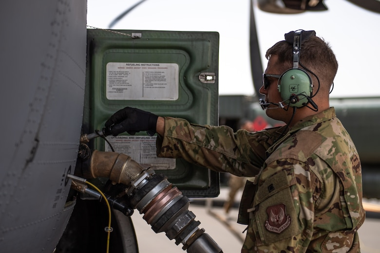 U.S. Air Force Staff Sgt. John Bouscher, 86th Aircraft Maintenance Squadron flying crew chief, refuels a C-130J Super Hercules at Nigerien Air Base 201, Agadez, Niger, Aug. 3, 2019. This was the first C-130 to take-off at Air Base 201, marking the beginning of limited Visual Flight Rules operations at the base. (U.S. Air Force photo by Staff Sgt. Lexie West)