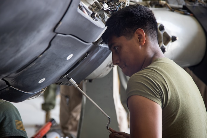 U.S. Marine Cpl. Bryant Castaneda, a tiltrotor mechanic assigned to Marine Medium Tiltrotor Squadron 263, conducts aircraft maintenance during Integrated Training Exercise 5-19 at Marine Corps Air Ground Combat Center, Twentynine Palms, Calif., Aug. 8, 2019. ITX 5-19 is a large scale, combined-arms training exercise that produces combat-ready forces capable of operating as a Marine Air-Ground Task Force. (U.S. Marine Corps photo by Cpl. Cody Rowe)