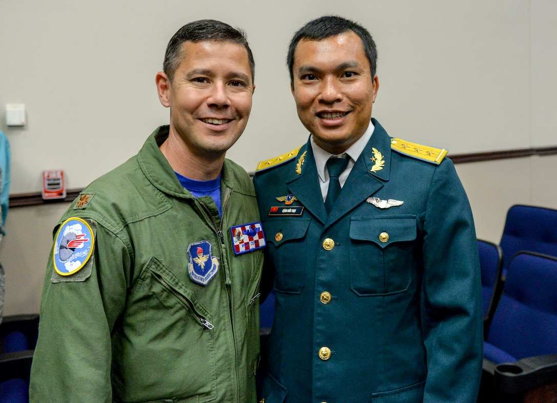 Maj. Dave Cote, 41st Flying Training Squadron instructor pilot and international military student officer, congratulates Capt. Toai Dang, from the Vietnam People's air force, following a graduation ceremony May 30, 2019, at Columbus Air Force Base, Mississippi. Dang became the first Vietnamese student from Vietnam Air Defense Air Force to graduate the Aviation Leadership Program at Columbus AFB. ALP is a U.S. Air Force-funded program, providing students of friendly and developing countries with undergraduate pilot training scholarships. (U.S. Air Force courtesy photo)