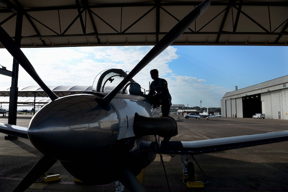 First Lt. Sanni Kafayat, 41st Flying Training Wing student pilot, climbs into the seat of a T-6 Texan II July 26, 2019, at Columbus Air Force Base, Mississippi. Kafayat is a student pilot from Nigeria. (U.S. Air Force photo by Airman 1st Class Jake Jacobsen)