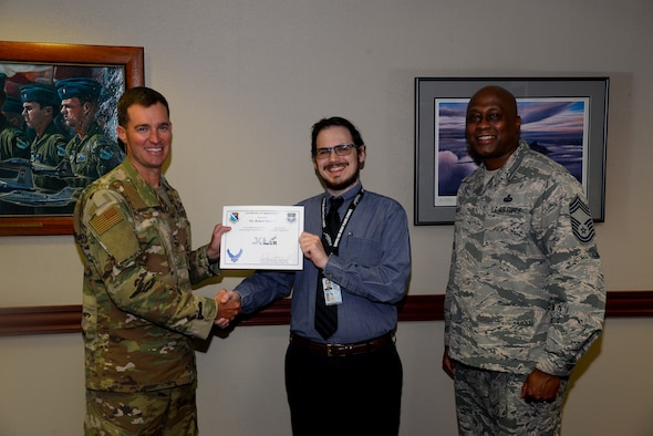 "Robert Marcell, the 47th Flying Training Wing historian, was chosen by wing leadership to be the ""XLer of the week"" for the week of August 5, 2019 at Laughlin Air Force Base, Texas. The ""XLer of the Week"" award, presented by Col. Todd Dyer, the 47th Flying Training Wing vice commander, and Chief Master Sgt. Ronald Harper, the 47 Mission Support Group superintendent, is given to those who consistently make outstanding contributions to their unit and the Laughlin mission. (U.S. Air Force photo by Senior Airman John A. Crawford)"