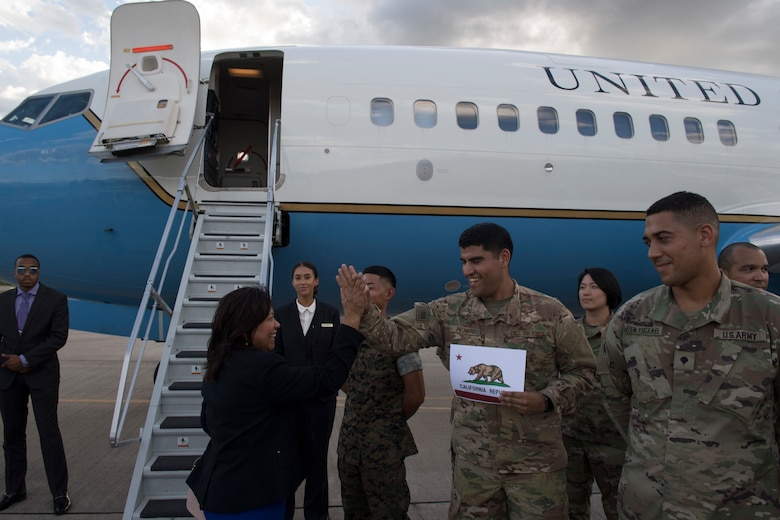 U.S. Air Force Staff Sgt. Christian Pizarro, 612th Air Base Squadron Air Traffic Control watch supervisor, hi-fives Rep. Norma Torres, California 35th district and House Committee on Rules member, during a visit, Aug. 10, 2019, at Soto Cano Air Base, Honduras Representatives from various states visited service members during a visit to Honduras, accompanying the Speaker of the House Nancy Pelosi. (U.S. Air Force photo by Staff Sgt. Eric Summers. Jr.)