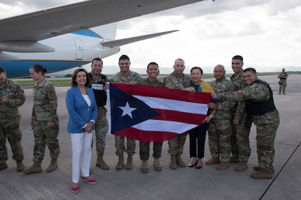 Service members from Puerto Rico pose with congressional representative and Speaker of the U.S. House of representatives, Aug. 10, 2019, at Soto Cano Air Base Honduras. Representatives from various states visited service members during a visit to Honduras, accompanying the Speaker of the House Nancy Pelosi..