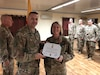 Col. Justin Osberg, commander of 108th Sustainment Brigade, congratulates Chief Warrant Officer 3 Nicole Matteson after presenting her the Military Outstanding Volunteer Service Medal at Camp Taji, Iraq, Aug. 10, 2019. Matteson volunteered over a four year period as a Den Leader with the Boy Scouts of America, Cub Scout Pack 38.