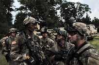 Florida National Guard Soldiers prepare and converse before moving onto lanes training at eXportable Combat Training Capability 19-05 at Camp Shelby, Mississippi.