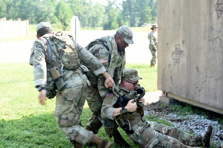 Florida National Guard Soldiers drag a mock casualty to a casualty collection point during lanes training at eXportable Combat Training Capability 19-05 at Camp Shelby, Mississippi.