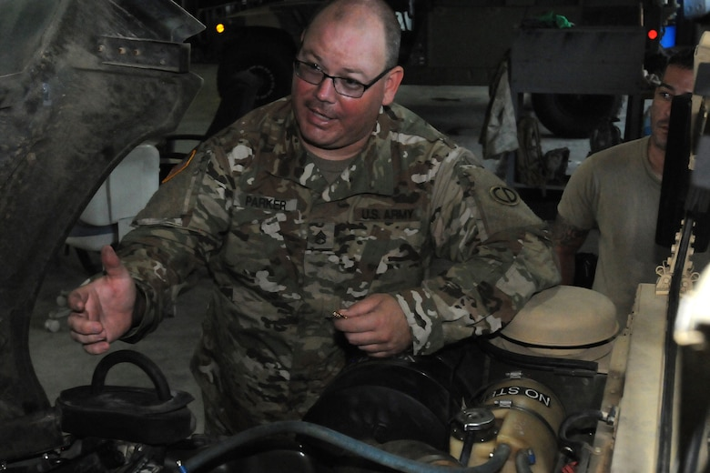 Staff Sgt. Jonathan Parker, lead mechanic, 3-349 Logistic Support Battalion, 85th U.S. Army Reserve Support Command and operationally controlled by First Army's 177th Armored Brigade, troubleshoots the overheating of an observer coach/trainer Humvee.