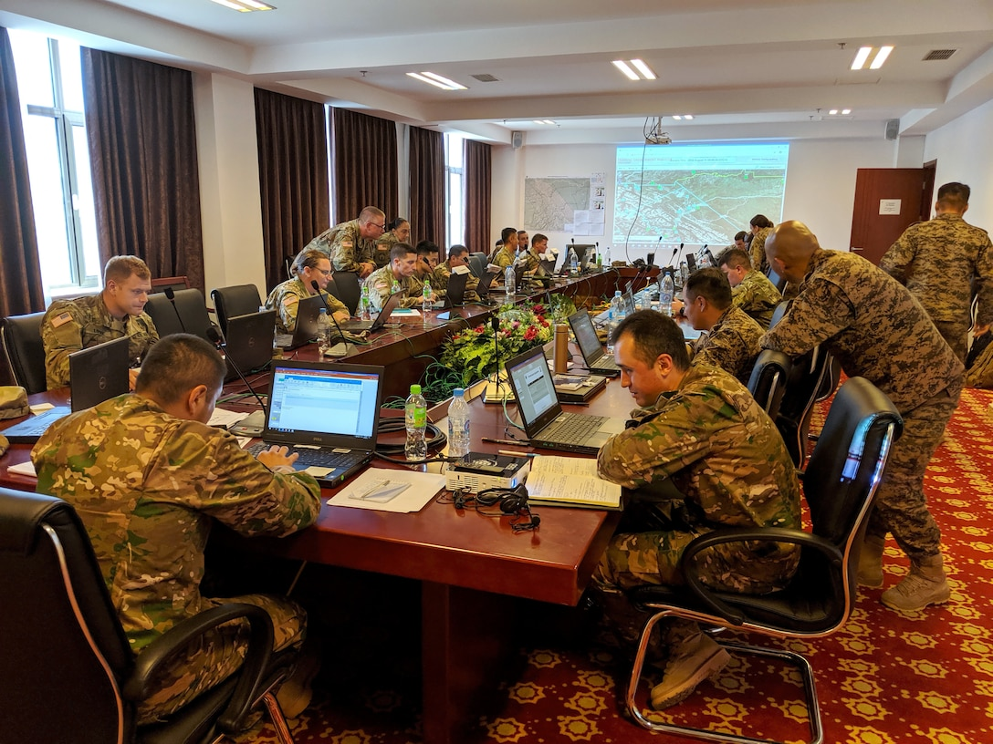 Service members from Mongolia, Tajikistan, United States and Uzbekistan work together to address security and stability issues within fictional countries during Exercise Regional Cooperation 2019 at Dushanbe, Tajikistan, August 10, 2019. Exercise Regional Cooperation is an annual exercise to help strengthen military-to-military relationships between the United States and partners in Central and South Asia. The exercise enhances regional security and stability among the participating nations of Mongolia, Tajikistan, United States and Uzbekistan. 