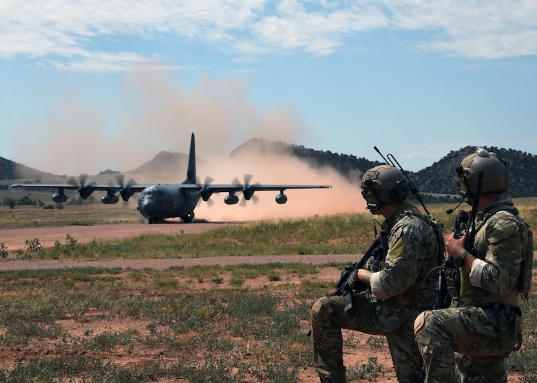 Tactical air control party Airmen from the 13th Air Support Operations Squadron watch a C-130 Hercules from the 302nd Airlift Wing land July 17, 2019 on Fort Carson, Colorado. The 302nd AW helped the 13th ASOS conduct a mission qualification training exercise by using their aircraft as part of their training. (U.S. Air Force photo by Airman 1st Class Andrew Bertain)