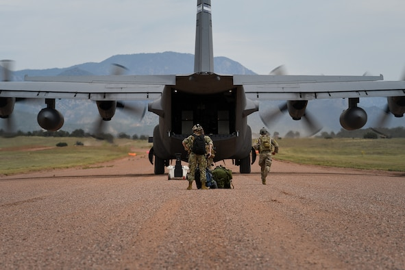 Airmen from the 13th Air Support Operations Squadron practice a contingency landing during mission qualification training July 17, 2019 on Fort Carson, Colorado. The group of Airmen were shuttled by a C-130 Hercules from the 302nd Airlift Wing on Peterson Air Force Base, Colorado. The C-130 was carrying a Humvee, the group of Airmen and all the equipment for their training.  (U.S. Air Force photo by Airman 1st Class Andrew Bertain)
