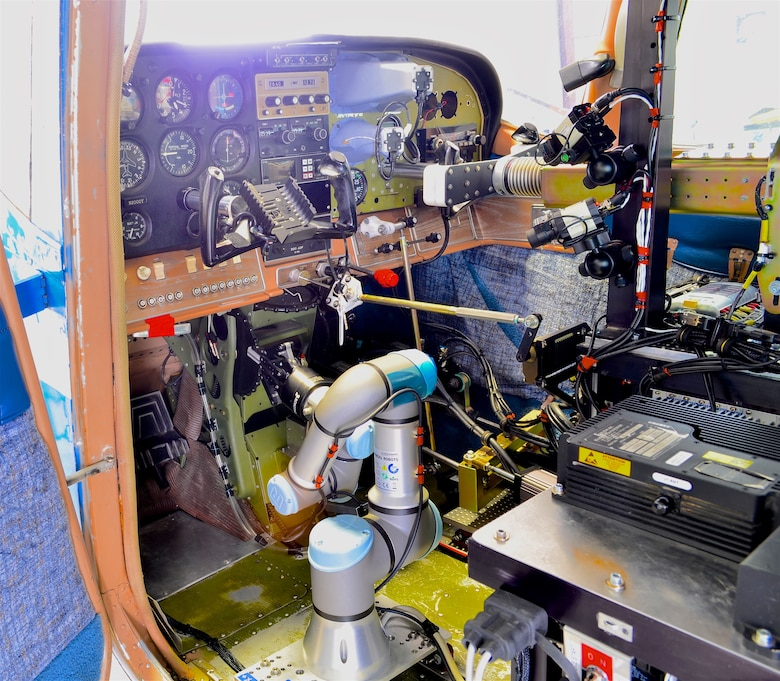 A Cockpit view of ROBOpilot attached to seat rails with no permanent modifications to the aircraft. (Courtesy photo)