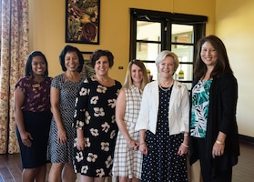 Dawn Goldfein (second from right), wife of Air Force Chief of Staff, Gen. David L. Goldfein, takes a photo with Hickam Community staff and spouses during a visit to the Ka Makani Community Center on Joint Base Pearl Harbor-Hickam, Hawaii, August 14, 2019. Goldfein also toured a house on the historic housing registry and the Child Development Center on base. (U.S. Air Force photo by Staff Sgt. Hailey Haux)