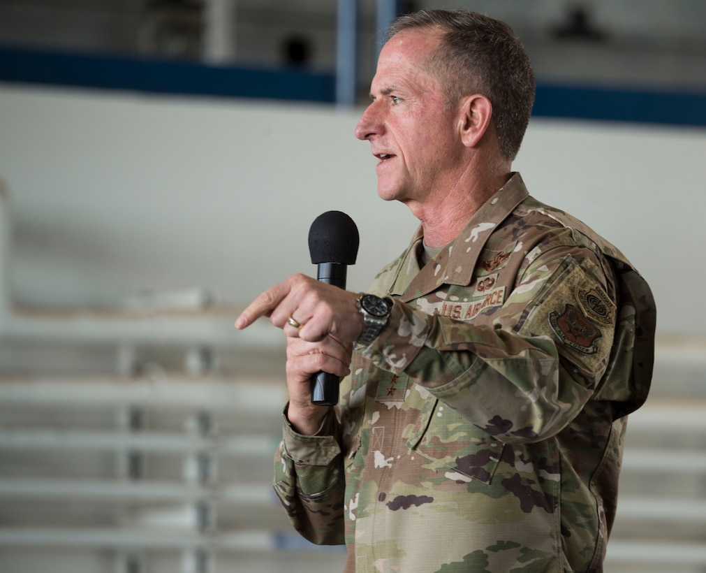 Air Force Chief of Staff Gen. David Goldfein speaks to Airmen during an all call at Joint Base Pearl Harbor-Hickam, Hawaii, Aug. 14, 2019. During the all call, Goldfein covered topics such as multi-domain operations, joint leaders and teams and the importance of squadrons in the Air Force. This was Goldfein's first stop as he visits various units in the Indo-Pacific. (U.S. Air Force photo by Tech. Sgt. Heather Redman)