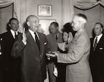Secretary of Defense Louis Johnson swears in U.S. Army Gen. Omar Bradley as the first chairman of the Joint Chiefs of Staff during a ceremony in Washington, D.C., Aug. 16, 1949.
