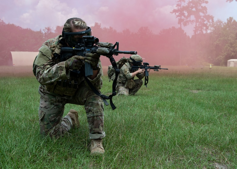 Staff Sgt. Miranda Roberts, 824th Base Defense Squadron fire team leader, aims down her sight during the Tactical Leaders Course, Aug. 10, 2019, at Moody Air Force Base, Ga. The 7-day course revolved around squad leaders developing their skills to effectively communicate, team build and mission plan. These skills were assessed during a 36-hour simulated operation where squad leaders lead Airmen through tactical situations. (U.S. Air Force photo by Airman Azaria E. Foster)
