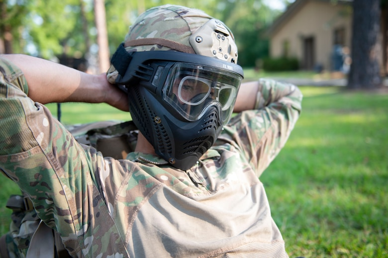 Airman 1st Class Andres Gonzales, 824th Base Defense Squadron fire team member, puts on a simunition mask during the Tactical Leaders Course, Aug. 10, 2019, at Moody Air Force Base, Ga. The 7-day course revolved around squad leaders developing their skills to effectively communicate, team build and mission plan. These skills were assessed during a 36-hour simulated operation where squad leaders lead Airmen through tactical situations. (U.S. Air Force photo by Airman Azaria E. Foster)