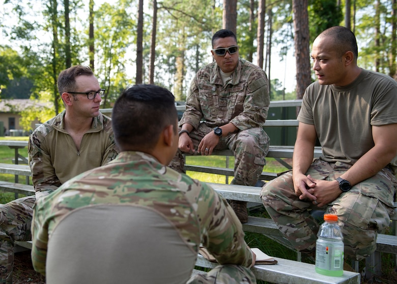 Participants of the Tactical Leaders Course discuss strategy during the course, Aug. 10, 2019, at Moody Air Force Base, Ga. The 7-day course revolved around squad leaders developing their skills to effectively communicate, team build and mission plan. These skills were assessed during a 36-hour simulated operation where squad leaders lead Airmen through tactical situations. (U.S. Air Force photo by Airman Azaria E. Foster)