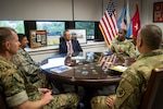 Marine Corps Col. Larry Herring, left front, and Air Force Col. John Gustafson, left rear, the DLA Aviation Richmond Marine Corps and Air Force Customer Facing Division chiefs, respectively, meet with Richard Ellis, rear center, DLA Troop Support Deputy Commander, Army Brig. Gen. Gavin Lawrence, rear right, DLA Troop Support Commander, and Air Force Col. Adrian Crowley, Industrial Hardware director, to discuss the role DLA Troop Support plays in supporting the Warfighter in Philadelphia Aug. 14, 2019.
