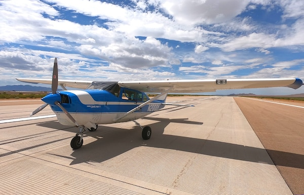 A 1968 Cessna 206 with ROBOpilot installed preparing for engine start on the runway at Dugway Proving Ground, Utah.  The Air Force Research Laboratory and DZYNE Technologies Incorporated successfully completed a two-hour initial flight of a revolutionary Robotic Pilot Unmanned Conversion Program called ROBOpilot Aug. 9 at Dugway Proving Ground, Utah.(Courtesy photo)