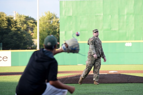 Army Reserve Staff Sgt. Clifford Arrington, Information Systems noncommissioned officer assigned to the 85th U.S. Army Reserve Support Command, throws in a ceremonial first pitch before a Joliet Slammers home game, August 13, 2019 in Joliet, Illinois.