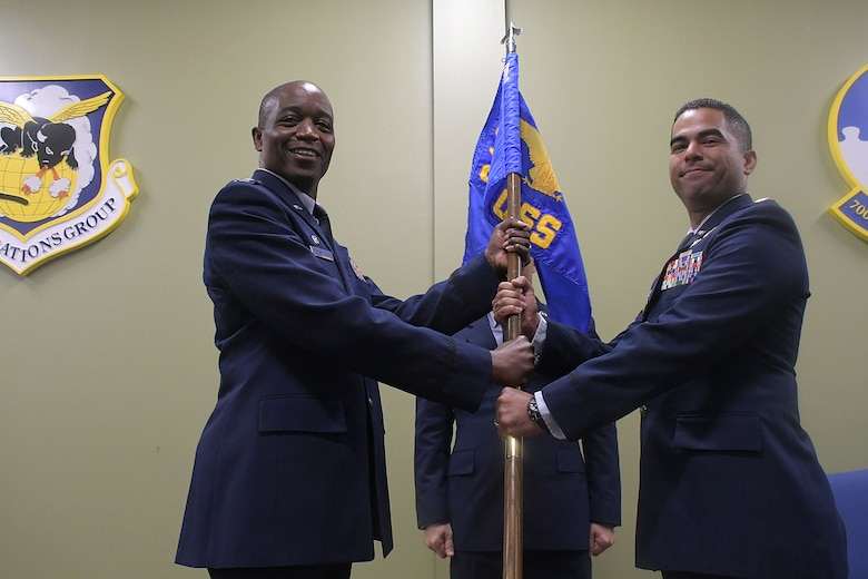 Maj. Oscar Rondon, right, receives the guidon from Col. Patrick Campbell, 94th Operations Group commander, Aug. 8, 2019.