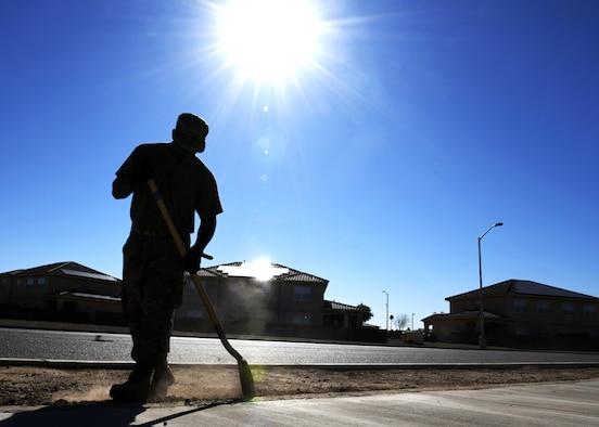 Tech. Sgt. Aaron Jones, 56th Civil Engineering Squadron pavements and heavy equipment operator, shovels dirt Aug. 12, 2019, at Luke Air Force Base, Ariz.