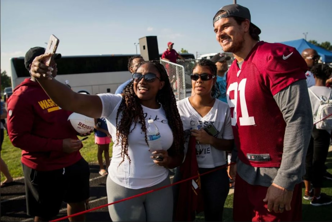 Fans take a selfie with Washington Redskins outside linebacker Ryan Kerrigan during a visit to Joint Base Andrews Aug. 14. The team held a special walkthrough practice here as part of ongoing Redskins Salute efforts presented by USAA. (Courtesy photo/Washington Redskins)