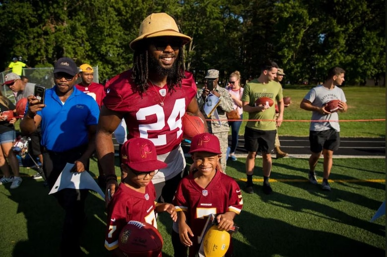 Washington Redskins cornerback Josh Norman poses with young fans during a visit to Joint Base Andrews Aug. 14. The team held a special walkthrough practice here as part of ongoing Redskins Salute efforts presented by USAA. (Courtesy photo/Washington Redskins)