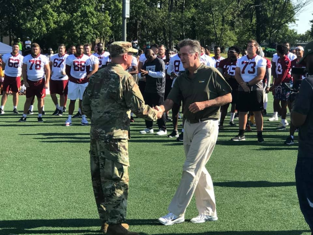 Air Force District of Washington Commander Maj. Gen. Ricky N. Rupp greets Washington Redskins team President Bruce Allen during the team's walkthrough practice here Aug. 14. (U.S. Air Force photo/Lt. Col. John Ross)