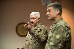 Lt. Gen. Scott L. Rice (left), director of the Air National Guard, discussesthe career accomplishments ofBrig. Gen. Warren Hurst, Kentucky's assistant adjutant general for Air, during a ceremony at the Kentucky Air National Guard base in Louisville, Ky., Aug. 10, 2019.Rice presented Hurst with theDistinguished Service Medal, which recognizesexceptionally meritorious service in duties of great responsibility.(U.S. Air National Guard photo by Dale Greer)