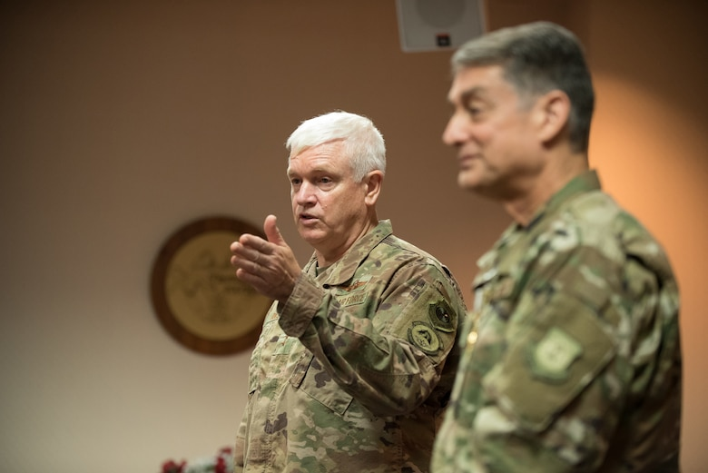 Lt. Gen. L. Scott Rice (left), director of the Air National Guard, discusses the career accomplishments of Brig. Gen. Warren Hurst, Kentucky's assistant adjutant general for Air, during a ceremony at the Kentucky Air National Guard base in Louisville, Ky., Aug. 10, 2019. Rice presented Hurst with the Distinguished Service Medal, which recognizes exceptionally meritorious service in duties of great responsibility. (U.S. Air National Guard photo by Dale Greer)