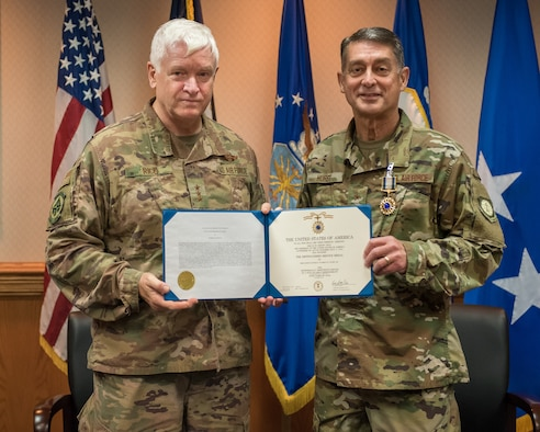 Lt. Gen. L. Scott Rice (left), director of the Air National Guard, presents the Distinguished Service Medal to Brig. Gen. Warren Hurst, Kentucky's assistant adjutant general for Air, during a ceremony at the Kentucky Air National Guard base in Louisville, Ky., Aug. 10, 2019. Hurst earned the honor for exceptionally meritorious service in duties of great responsibility. (U.S. Air National Guard photo by Dale Greer)