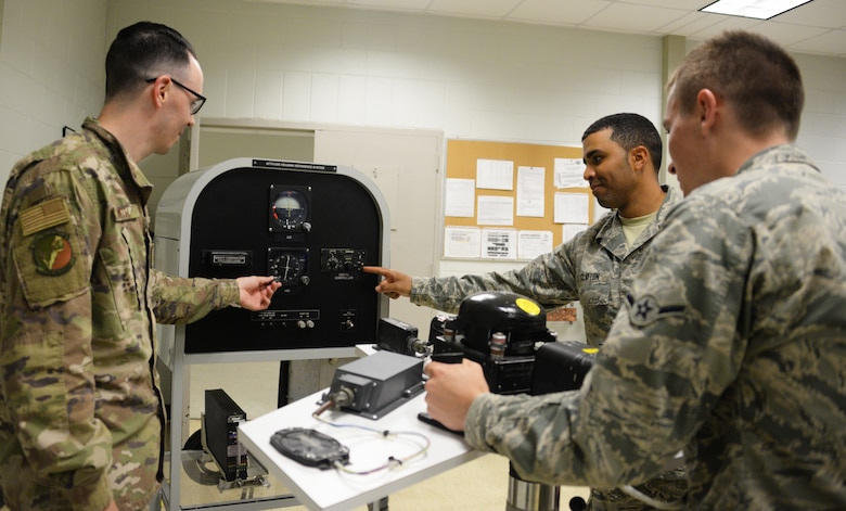 365th Training Squadron instructor and students review a basic navigation system at Sheppard AFB