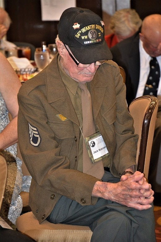 Jack Robinson, a World War II veteran of the 94th Infantry Division, pauses for a moment of prayer and reflection at the 70th anniversary of the 94th Infantry Division Historical Society's annual reunion in Columbus, Georgia, June 14-15, 2019. The 94th Training Division-Force Sustainment coordinated with the 94th IDHS to hold the reunion where 94th veterans, families and friends came together to honor and remember their rich history and legacy.