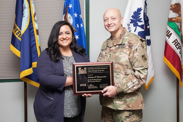Maj. Gen. Anthony Funkhouser, USACE Deputy Commanding General for Military and International Operations, presents Arianna Raymundo, Sacramento District Army/Air Force section chief, with the 2019 USACE Project Manager of the Year Award.
