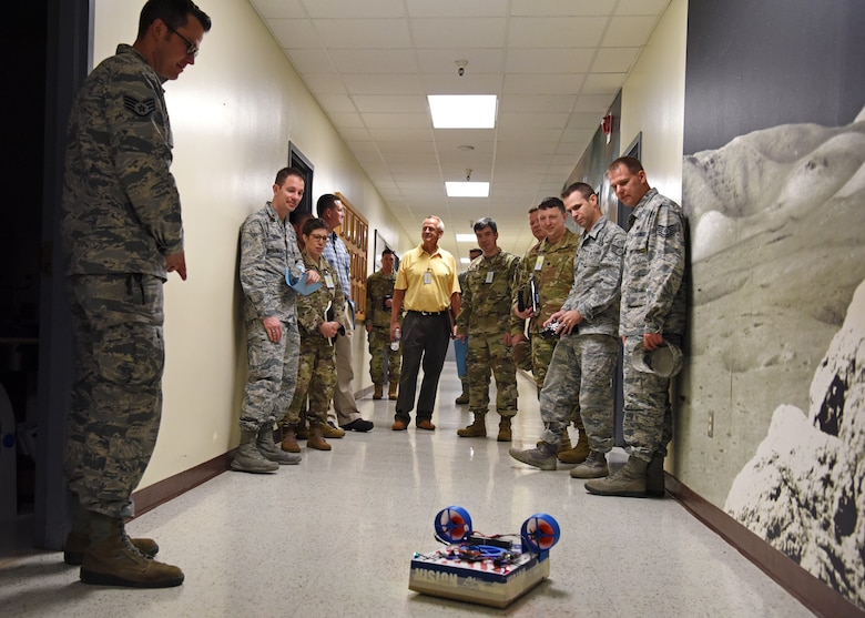 U.S. Air Force personnel from The National Air and Space Intelligence Center observe a hovercraft made by 312th Training Squadron students from scrap and 3-D printed parts on Goodfellow Air Force Base, Texas, August 13, 2019. Students are challenged to think outside the box and break things to improve and create other things. (U.S. Air Force photo by Airman 1st Class Ethan Sherwood/Released)