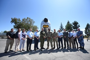 Five Eyes Air Force Interoperability Council representatives stand outside the Heritage Center at Travis Air Force Base, California, Aug. 9, 2019. The group, which comprises armed forces members from Australia, Canada, New Zealand, the United Kingdom and the United States, meets annually to discuss, learn and test existing and new interoperability strategies. (U.S. Air Force photo by Senior Airman Christian Conrad)