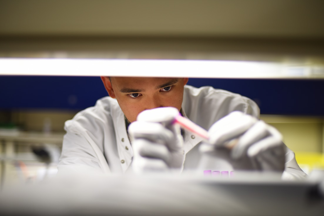 U.S. Air Force Senior Airman Philip Fisketjon, 341st Medical Group medical laboratory technician, examines a complete blood count at the laboratory on Malmstrom Air Force Base, Montana, Aug. 13, 2019. Medical laboratory technicians play an integral role in providing patients with a proper diagnosis and treatment by conducting essential tests on body substances. (U.S. Air Force photo by Airman 1st Class Jacob M. Thompson)