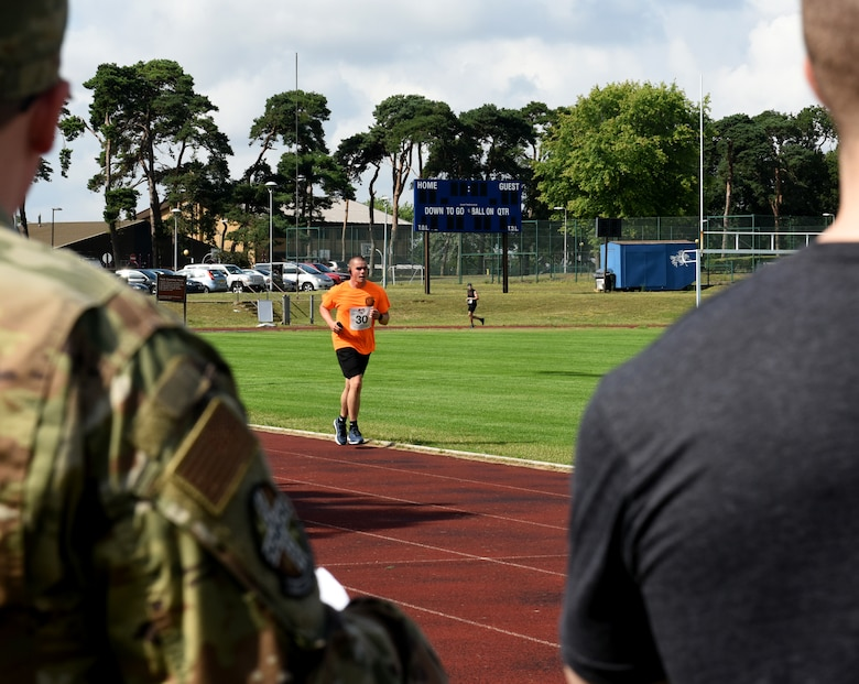 A Liberty Wing Airman participates in the Operation Warm Heart run-a-thon at Royal Air Force Lakenheath, England, Aug. 2, 2019. Operation Warm Heart is a non-profit organization through the First Sergeant Council that provides emergency funds and relief for Airmen. (Courtesy photo by Carissa Chae)