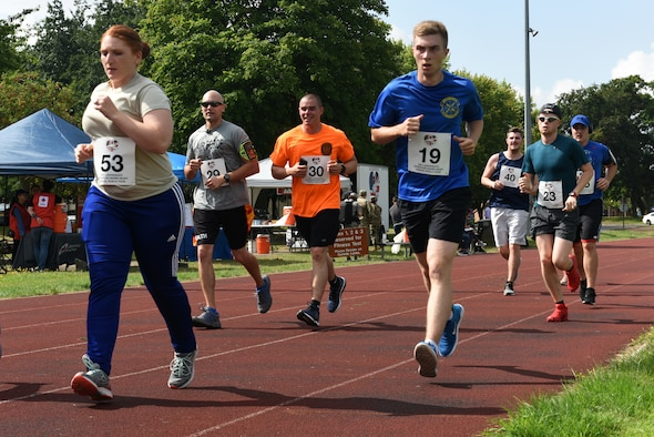 Liberty Wing Airmen participate in the Operation Warm Heart run-a-thon at Royal Air Force Lakenheath, England, Aug. 2, 2019. Operation Warm Heart is a non-profit organization through the First Sergeant Council that provides emergency funds and relief for Airmen. (Courtesy photo by Carissa Chae)