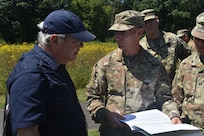 New York Army National Guard Maj. Jason Cossey speaks with James Hughto on a training exercise, at Saratoga Battlefield, Saratoga, N.Y., on Aug. 14, 2019. Cossey and other Soldiers were participating in the Commander's Career Course, and getting a tour of Saratoga Battlefield.