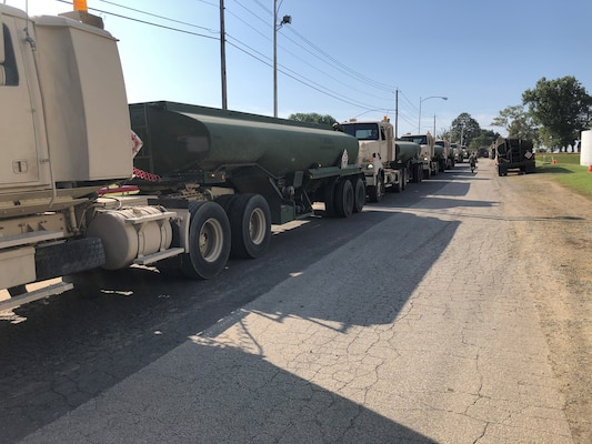 military fuel trucks line up