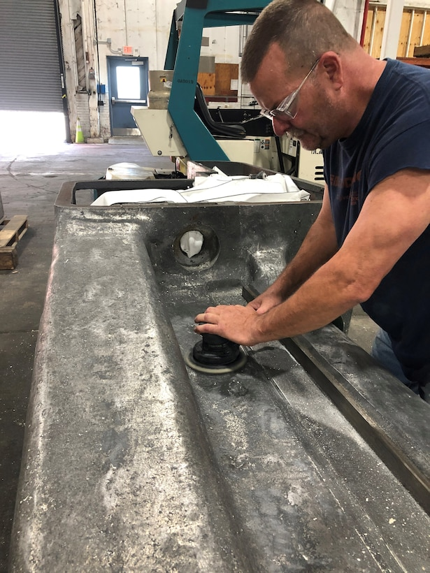 Painter Jody Lindsey sands drill press arm