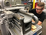 Mechanic Kristopher Nace refurbishes a Lathe