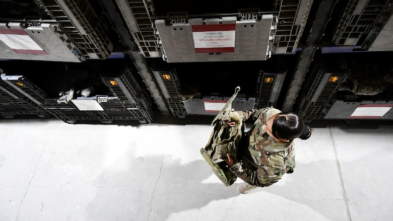 Airman 1st Class Brianna Renninger, 386th Expeditionary Logistics Readiness Squadron expeditionary theater distribution center journeyman, picks a piece of body armor from a bin at Ali Al Salem Air Base, Kuwait, Aug. 13, 2019. Theater distribution facilities stock items in theater for forward-deploying Airmen. Having the stock in country eliminates the need to transport the additional weight and mission-essential gear during military movements. (U.S. Air Force photo by Staff Sgt. Mozer O. Da Cunha)