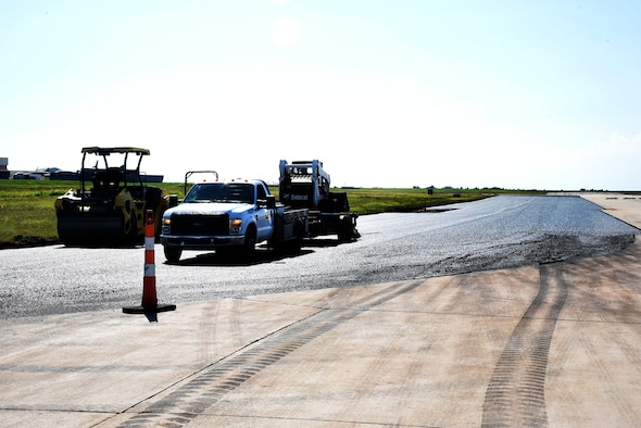 Runway 13/31 is currently undergoing construction to the outer 75ft. on each side, receiving fresh asphalt. (U.S. Air Force photo/Kelly White)