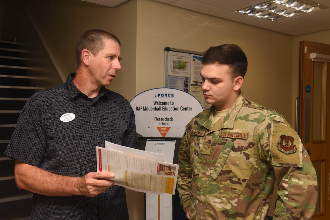 James Sarosi, 100th Force Support Squadron education services specialist, speaks with Airman 1st Class Brandon Lemon, 100th Logistics Readiness Squadron ground transportation apprentice, about degree options at RAF Mildenhall, England, Aug. 15, 2019. Counselors at the education office assist Airmen in realizing the benefits and opportunities available to them as military members. (U.S. Air Force photo by Airman 1st Class Joseph Barron)