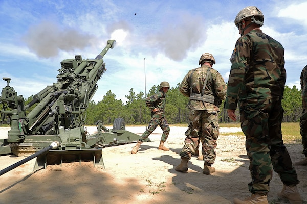 Moldovan National Army Lt. Victor Suceanu, a field artillery officer, fires an M777A2 Howitzer during a visit to the 139th Regional Training Institute at Fort Bragg on Aug. 12, 2019.  The North Carolina National Guard has partnered with Moldova for over 20 years as part of the State Partnership Program.