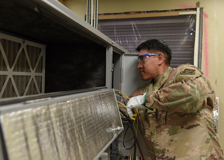 Staff Sgt. Andre Chamilco, 366th Training Squadron HVAC/R craftsman course student, ensures a ventilation system is properly functioning at Sheppard Air Force Base, Texas, Aug. 14, 2019. HVAC/R technicians are essential for the functionality of a base. Having proper heating and cooling systems within buildings assists with the welfare of base personnel. (U.S. Air Force photo by Senior Airman Ilyana A. Escalona)