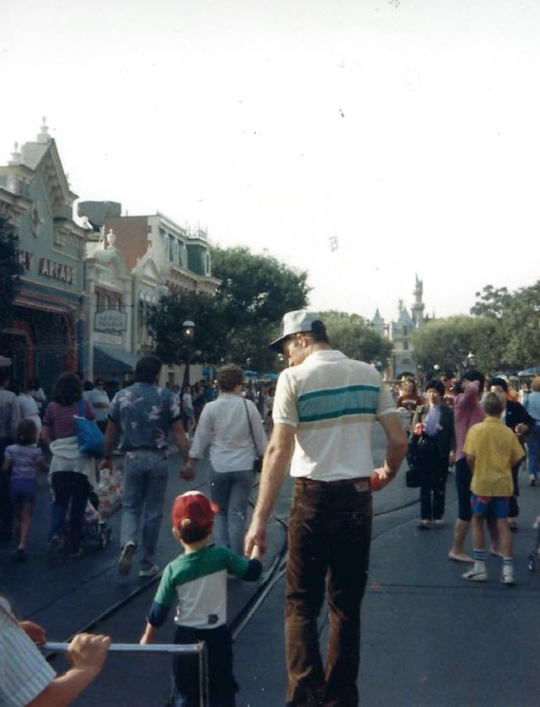 Lt. Col. Kenneth Huston and his son Jeffrey walk down Main Street at Disneyland. (Courtesy Photo)
